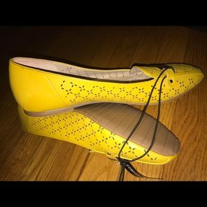 Women's yellow perforated flats